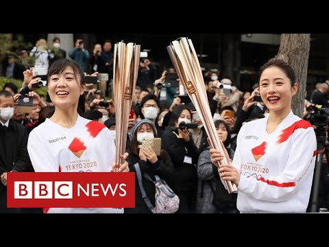 Japan warns fans not to cheer during Olympics to prevent Covid surge – BBC News